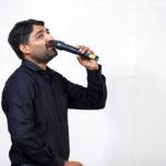 man singing in a mic