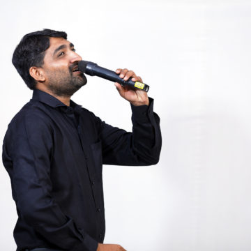 man singing in a mic